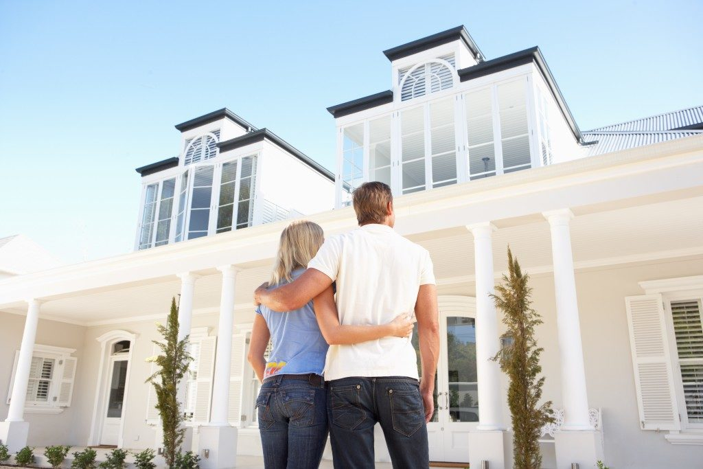 couple looking at a big house