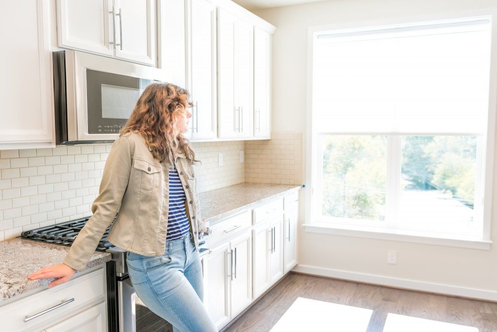 woman standing in a new kitchen