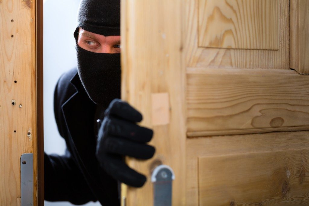 disguised burglar breaking in