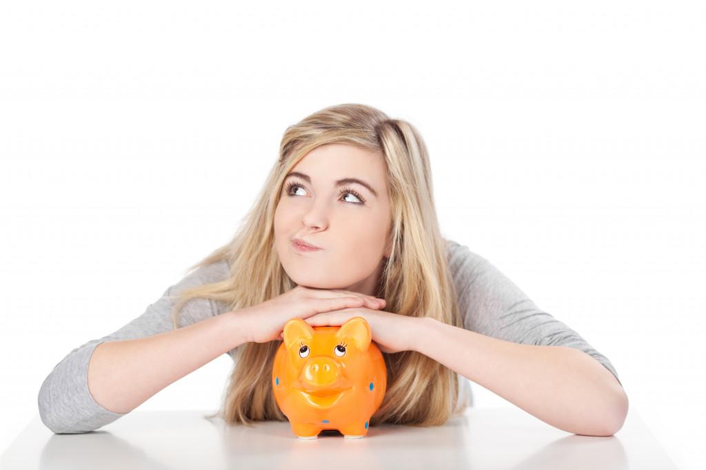 woman on piggy bank