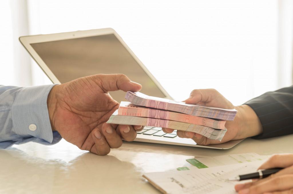 man receiving loan