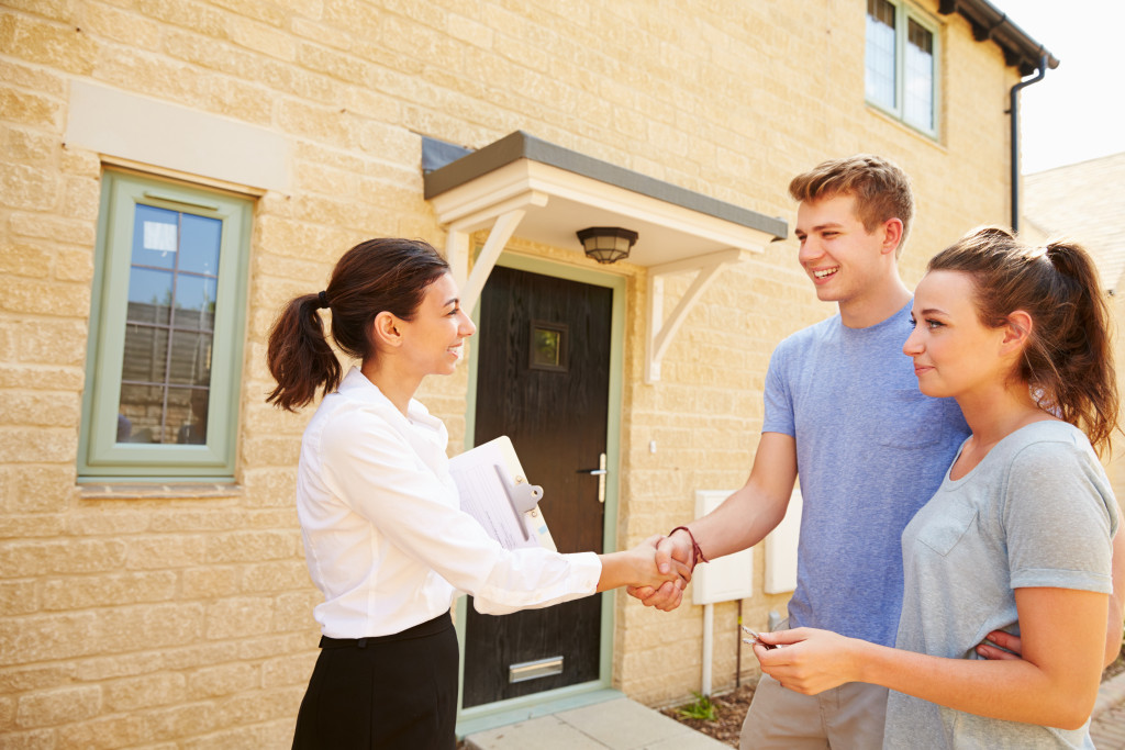 realtor shaking hands with clients